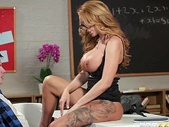 This busty blonde teacher, Stacey Saran, knows how to encourage her not really successful students to work more and harder. Just take a peek inside one of our classrooms and you won't be disappointed. She fucks with her students!!!