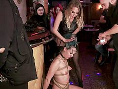 Sexy babe, Liz Rainbow, just joined our friendly group and to become one of us, she should go through different testings. First, she will be fucked and disgraced in a public place. Watch crazy humiliation in a crowded bar!