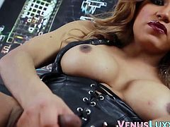 Busty tbabe in leather costume makes her big dick cum