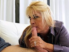 This slutty milf knows what she wants and she will get it with the help of this handsome guy. The busty blonde notices a big bulge in his pants and jumps on him. She licks his hard cock sensually and sucks on his swollen balls, then bends over, and Michael fingers her hairy pussy.