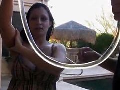 Aria Giovanni takes a beer bong on the pool
