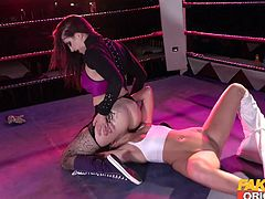 The winner of this kinky boxing match gets the right to punish his opponent and dominate him. Tindra Frost sits on Honour's face, while the blonde babe licks and fingers the busty milf's wet cunt. Guess how fast she won?