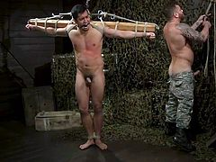It is a cruel test for real men and of course, Tony Prower could not pass by. The handsome guy is in a standing position, while his shoulders and arms are tied with ropes to a wooden beam. Riley Mitchell beats him with a whip and pinches his sensitive nipples, and this is only the beginning...