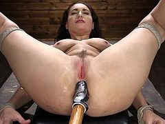 The master choked her a little and then put one finger in Gabriella's tight pussy and a huge dildo in her asshole. Despite the fact that she is bound with ropes and looks like no one asks about her desires, the brunette milf has a smile of pleasure on her face and moans with joy