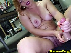 Classy cougar with bigtits tugging younger studs cock
