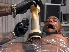 Ah, this is a beautiful sight for those who appreciate refined bdsm punishments! Micah's big black cock draws so much attention that his tormentor, Jason Collins, decides to start with it, using a special kinky device. Join to enjoy hot interracial gay bondage!