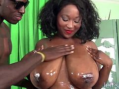 Ebony plumper gets her tits massaged with oil Then she sucks a black dick and then takes it in her pussy and gets fucked She gets her ass oiled too and gives a tit fuck She takes cum in her mouth