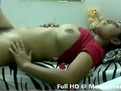 http://www.rupshikarai.com/ Busty Indian girl masturbates her hairy pussy with red thing