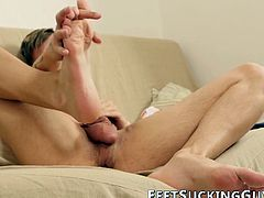 Feet fetish twink strokes his fat cock while moaning loud