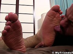 Muscular jock Ricky Larkin got amazed by the look of his friends amazing feet. From all the excitement he had to give him a good morning lick.