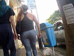 milf in shiny spandex walking