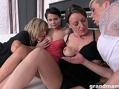 three mature women have fun with younger lady